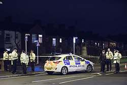 © Licensed to London News Pictures . 31/12/2016 . Oldham , UK . Police and forensic scenes of crime examiners at Ashton Road in Oldham , where it's reported one girl died and another was critically injured , following a hit and run incident this evening (31st December 2016) . Photo credit : Joel Goodman/LNP