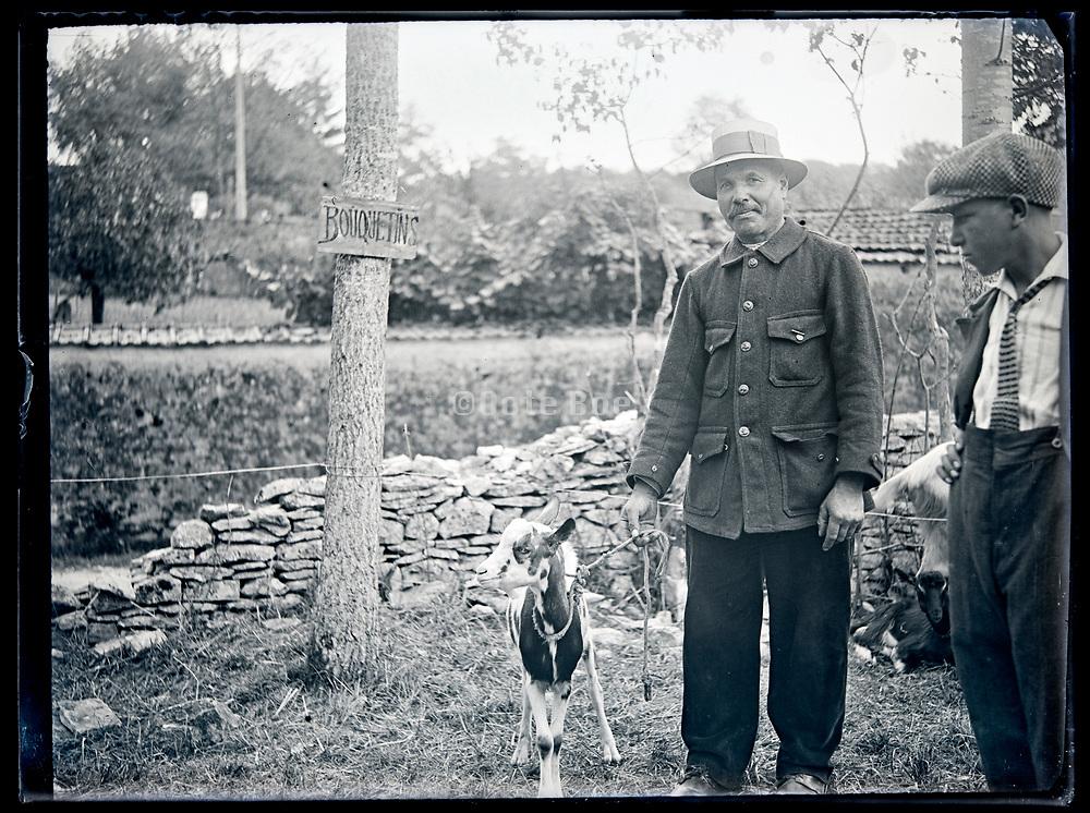 goat farmer with animal circa 1930s France