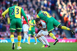 Olivier Giroud of Arsenal goes down following a tackle with Sebastien Bassong of Norwich City  - Mandatory byline: Jason Brown/JMP - 07966386802 - 30/04/2016 - FOOTBALL - Emirates Stadium - London, England - Arsenal v Norwich City - Barclays Premier League