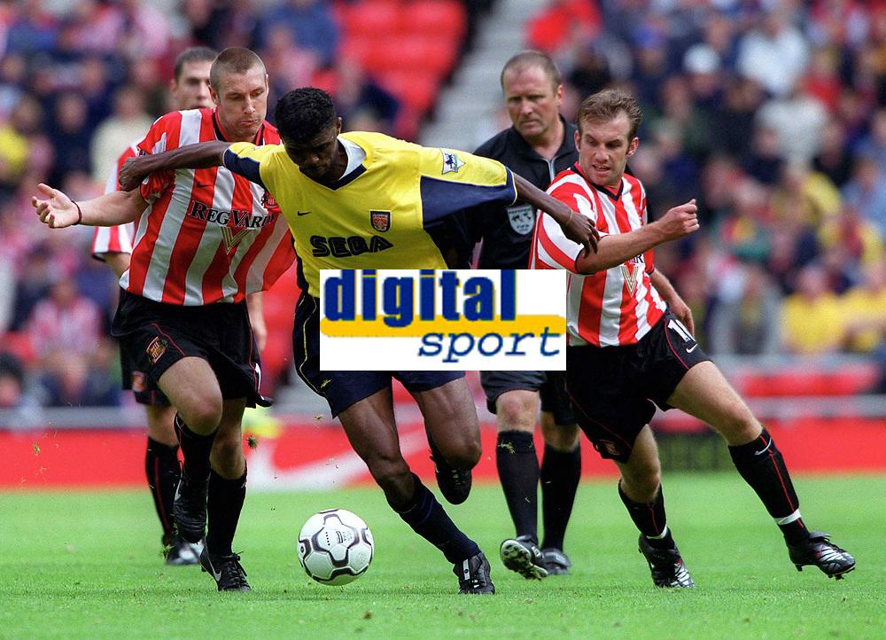 Kanu (Arsenal) bursts past Darren Holloway (left) and Darren Williams (Sunderland). Sunderland 1:0 Arsenal. FA Premiership,19/8/2000. Credit Colorsport / Stuart MacFarlane.
