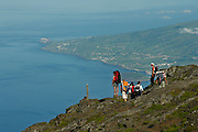 Hikers look at the canal between Pico and Faial islands. Faial is seen on the top right side.<br />Pico mountain is the highest portuguese point with 2351m.