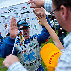 Telmex Chip Ganassi Racing with Felix Sabates BMW Riley driver Scott Pruett celebrates with fans after winning the series championship.in the Grand-Am Rolex Sports Car Series Championship Race at Lime Rock Park in Lakeville, Conn.