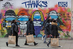 © Licensed to London News Pictures.  12/04/2021. Lonond, UK. Shoppers are seen at Oxford Street, central London as the government takes the next step on its lockdown-lifting road map and non-essential shops reopen today. Photo credit: Marcin Nowak/LNP