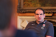 Martin Johnson looks on in a press conference after the England elite player squad trainnig session at Pennyhill Park, Bagshot, UK, on 11th March 2011  (Photo by Andrew Tobin/SLIK images)