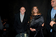BRIAN CLARKE; ZAHA HADID, The Summer party 2011 co-hosted by Burberry. The Summer pavilion designed by Peter Zumthor. Serpentine Gallery. Kensington Gardens. London. 28 June 2011. <br /> <br />  , -DO NOT ARCHIVE-© Copyright Photograph by Dafydd Jones. 248 Clapham Rd. London SW9 0PZ. Tel 0207 820 0771. www.dafjones.com.