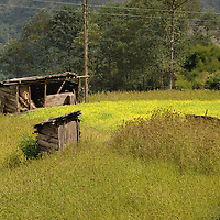 A run-down shack and outhouse off a trail in Nepal.