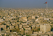 A view of the city looking north in late evening from high on the balcony of a nearby hotel - Amman, Jordan.