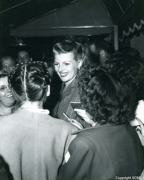 1955 Rita Hayworth and fans outside Mocambo Nightclub in West Hollywood