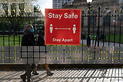 With new local coronavirus lockdown measures now in place and Birmingham currently set at 'Tier 2' or 'high', people wearing face masks pass a bus shelter 'stay safe' sign in the city centre on 14th October 2020 in Birmingham, United Kingdom. This is the first day of the new three tier system in the UK which has levels: 'medium', which includes the rule of six, 'high', which will cover most areas under current restrictions; and 'very high' for those areas with particularly high case numbers. Meanwhile there have been calls by politicians for a 'circuit breaker' complete lockdown to be announced to help the growing spread of the Covid-19 virus.