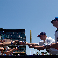 Kansas City Royals prospect Luke Hochevar (cq), right, and Clevand prospect Chuck Lofgren (cq), left, of the U.S. Team, sign autographs on the field before the 2007 XM All-Star Futures Game, Sunday, July 8 at AT&T Park in San Francisco...Photo by David Calvert/MLB.com