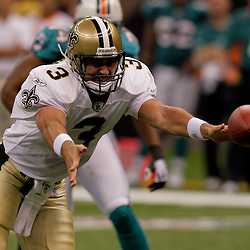 2009 September 03: New Orleans Saints quarterback Joey Harrington (3) pitches the football to running back P.J. Hill (not pictured) during a preseason game between the Miami Dolphins and the New Orleans Saints at the Louisiana Superdome in New Orleans, Louisiana.
