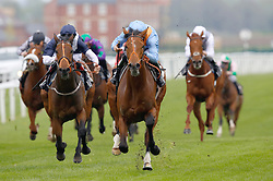 Raymond Tusk and Tom Marquand (centre) win Division II of The Dubai Duty Free Tennis Championships Maiden Stakes Race run during Dubai Duty Free Spring Trials Saturday at Newbury Racecourse.