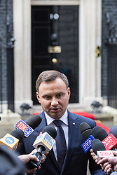 © Licensed to London News Pictures. 15/09/2015. London, UK. Polish President Andrzej Duda talks with Polish medai outside Number 10 Downing Street.  Photo credit : James Gourley/LNP