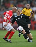 Photo: Rich Eaton.<br /> <br /> Cheltenham Town v Nottingham Forest. Coca Cola League 1. 13/10/2007. Forest's Chris Cohen (R) slots the ball past Alan Wright (L).