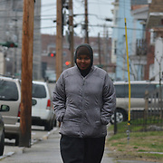 LEWISTON, Maine,  -- 4/2/16 --  Fahmo Ahmed, 28, walks toward her home in Lewiston. She came to the United States from Somalia 12 years ago, graduated from Edward Little, earned her citizenship and working her way towards graduation from college this year. A vibrant community organizer and advocate for women's reproductive rights, she hopes someday to run for office. Photo by Roger S. Duncan for The Forecaster
