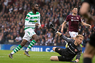 GOAL - Odsonne Edouard of Celtic places the ball over the advancing Zdenek Zlamal of Hearts to give his side the lead during the William Hill Scottish Cup Final match between Heart of Midlothian and Celtic at Hampden Park, Glasgow, United Kingdom on 25 May 2019.