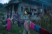 Hanging the washing at dusk near Dhading.