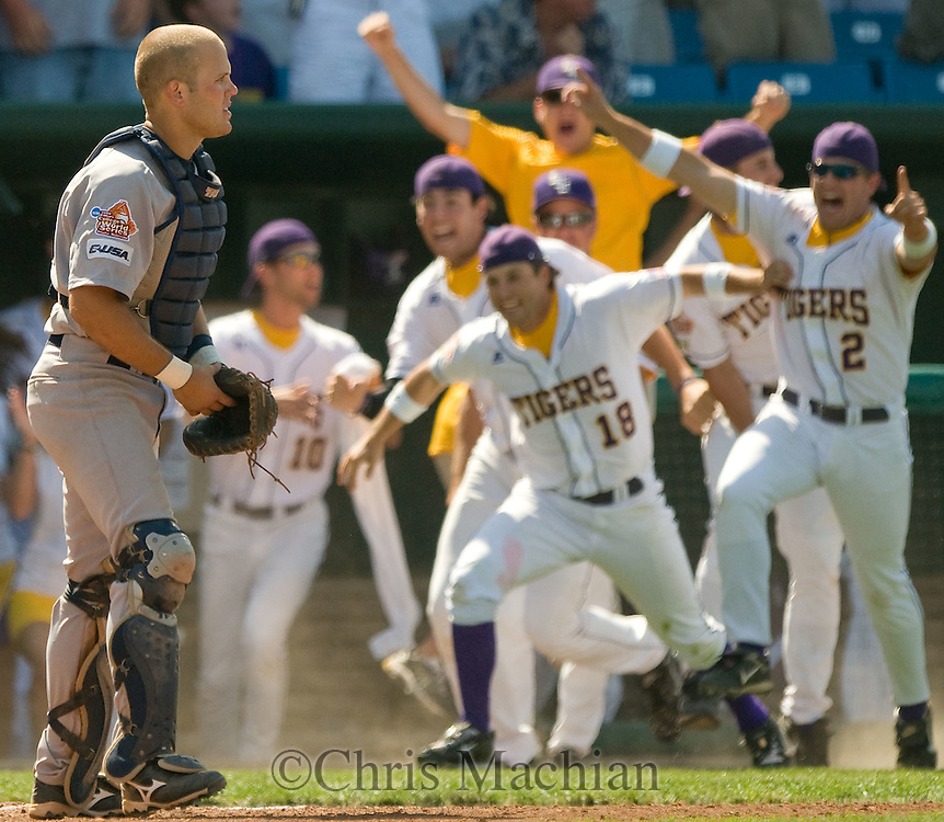 6/17/08 Omaha, NEB.Rice catcher Adam Zornes can only watch as LSU makes an amazing 9th inning come-back and leaves the dugout to celebrate their win at Rosenblatt Stadium during the College World Series. Photo by Chris Machian