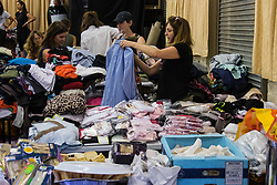 London, June 14th 2017. As fire rages through a residential tower block, Grenfell Tower, in Kensington, West London, local residents show their generosity as well-wishers pour into the Maxilla Social Club with clothing, food, water and blankets for the residents of the block who will have lost everything. PICTURED:  Volunteers sort through the mountains of clothing donated by London's well-wishers.