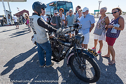 Justin Rinker of IL talks to tourists about his 1916 Indian at a fuel stop just over the Califonia/Arizona border during the Motorcycle Cannonball Race of the Century. Stage-14 ride from Lake Havasu CIty, AZ to Palm Desert, CA. USA. Saturday September 24, 2016. Photography ©2016 Michael Lichter.