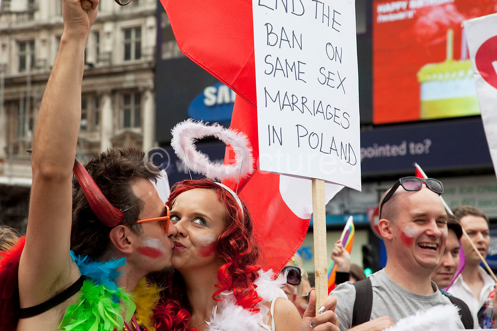 Placard reads: End the ban on same sex marriage in Poland. Pride London gay and lesbian parade through central London. Pride London (founded in 2004) aims to promote equality and diversity through all of its campaigns. The Pride London festival uses theatre, music, debate, art and entertainment to raise awareness of discrimination and the issues and difficulties affecting the lives of lesbian gay bisexual and transgender people around the world. The annual parade is an explosion of Pride in the heart of the capital, attracting over 1,000,000 people in a celebration of diversity.