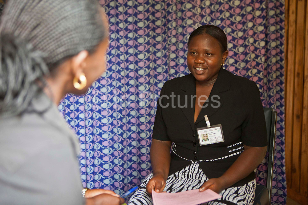 A HIV counsellor talks to a patient at the Voluntary Counselling and Testing clinic for HIV and TB at the Bwindi Community Hospital.  The hospital is in Buhoma village on the edge of the Bwindi Impenetrable Forest in Western Uganda. It serves around 60 000 people from the surrounding area.