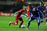 Jonathan Williams of Wales looks to go past Croatia's Dejan Lovren and Milan Badelj.  FIFA World cup 2014 qualifier, group A , Wales v Croatia at the Liberty Stadium in Swansea, South Wales on Tuesday 26th March 2013. pic by Andrew Orchard, Andrew Orchard sports photography,