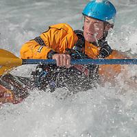 A kayaker paddles through rapids in the Kananaskis River near Calgary, Alberta, Canada.
