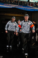 KELOWNA, CANADA - JANUARY 18:  Ice officials Kevin Crowell and Tim Plamondon, linesman and Brett Iverson, referee, walk to the ice at the Kelowna Rockets against the Moose Jaw Warriors on January 18, 2017 at Prospera Place in Kelowna, British Columbia, Canada.  (Photo by Marissa Baecker/Shoot the Breeze)  *** Local Caption ***