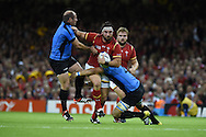 Scott Baldwin of Wales runs at Matias Beer (l) and Santiago Vilaseca of Uruguay ®.Rugby World Cup 2015 pool A match, Wales v Uruguay at the Millennium Stadium in Cardiff, South Wales  on Sunday 20th September 2015.<br /> pic by  Andrew Orchard, Andrew Orchard sports photography.