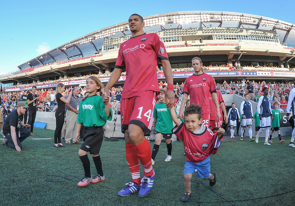 Ottawa Fury FC defender Onua Obasi (#14) walks out onto the field for the Amway Canadian Championship semi-final first leg match between the Ottawa Fury FC and the Vancouver Whitecaps at TD Place Stadium in Ottawa, ON. Canada on June 1, 2016.<br /> <br /> PHOTO: Steve Kingsman/Freestyle Photography