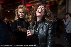 "EICMA's Ela Dutch with photographer Monica Silva Portrait, at the ""Live the Night Faster"" party hosted by Yamaha at the Officine del Volo during EICMA, the largest international motorcycle exhibition in the world. Milan, Italy. November 17, 2015.  Photography ©2015 Michael Lichter."