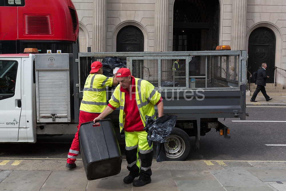 Workers with City of London street contractor Amey, load plastic bags of litter and waste into their van outside the Bank of England, on 3rd September 2018, in London England. Amey PLC provides street cleansing and waste collection services on behalf of the City of London Corporation, along with bespoke total waste management solutions to businesses in and around the City of London. Ameys workforce of 19,000 works across four continents – making us a leading supplier of consulting and infrastructure support services both in the UK and internationally.