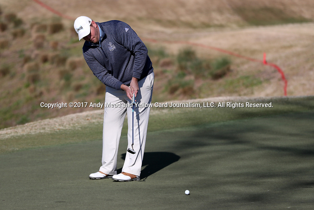 WILMINGTON, NC - MARCH 19: UNC Wilmington's Austin Inman putts on the Ocean Course fourth hole. The first round of the 2017 Seahawk Intercollegiate Men's Golf Tournament was held on March 19, 2017, at the Country Club of Landover Nicklaus Course in Wilmington, NC.