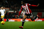 Romaine Sawyers of Brentford takes a shot at goal. EFL Skybet football league championship match, Brentford v Sheffield Wednesday at Griffin Park in London on Saturday 30th December 2017.<br /> pic by Steffan Bowen, Andrew Orchard sports photography.