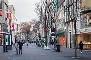 Corona Lockdown, December 16th. 2020. Only few people on shopping street Schildergasse, usually visited by thousands of people, Cologne, Germany.<br /> <br /> Corona Lockdown, 16. Dezember 2020. Nur sehr wenige Menschen in der Fussgaengerzone Schildergasse, normalerweise von tausenden Menschen besucht,  Koeln, Deutschland.