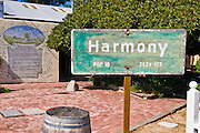 Town sign and mural describing the history of Harmony, California