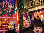 22 DECEMBER 2017 - HANOI, VIETNAM: Catholic nuns watch the Christmas show at St. Joseph's Cathedral in Hanoi. There are about 5.6 million Catholics in Vietnam. The Cathedral was one of the first structures built by the French during the colonial era and was opened in 1886. It's one of the most popular tourist attractions in Hanoi.    PHOTO BY JACK KURTZ
