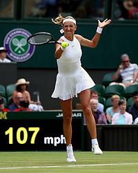 Victoria Azarenka in action against Karolina Pliskova on day three of the Wimbledon Championships at the All England Lawn Tennis and Croquet Club, Wimbledon.