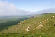 Fog clearing from chalk downs scarp slope Pewsey Vale, near Knap Hill, Alton Barnes, Wiltshire, England, UK