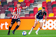 Brentford midfielder Vitaly Janelt (27) and Middlesbrough midfielder Lewis Wing (8) during the EFL Sky Bet Championship match between Brentford and Middlesbrough at Brentford Community Stadium, Brentford, England on 7 November 2020.