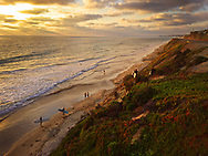 Surfers leaving and walking up the bluffs in Del Mar, CA at sunset. - San Diego Lifestyle Photographer, San Diego Lifestyle Photographers<br /> <br /> CONTACT US FOR PRICING AND USAGE