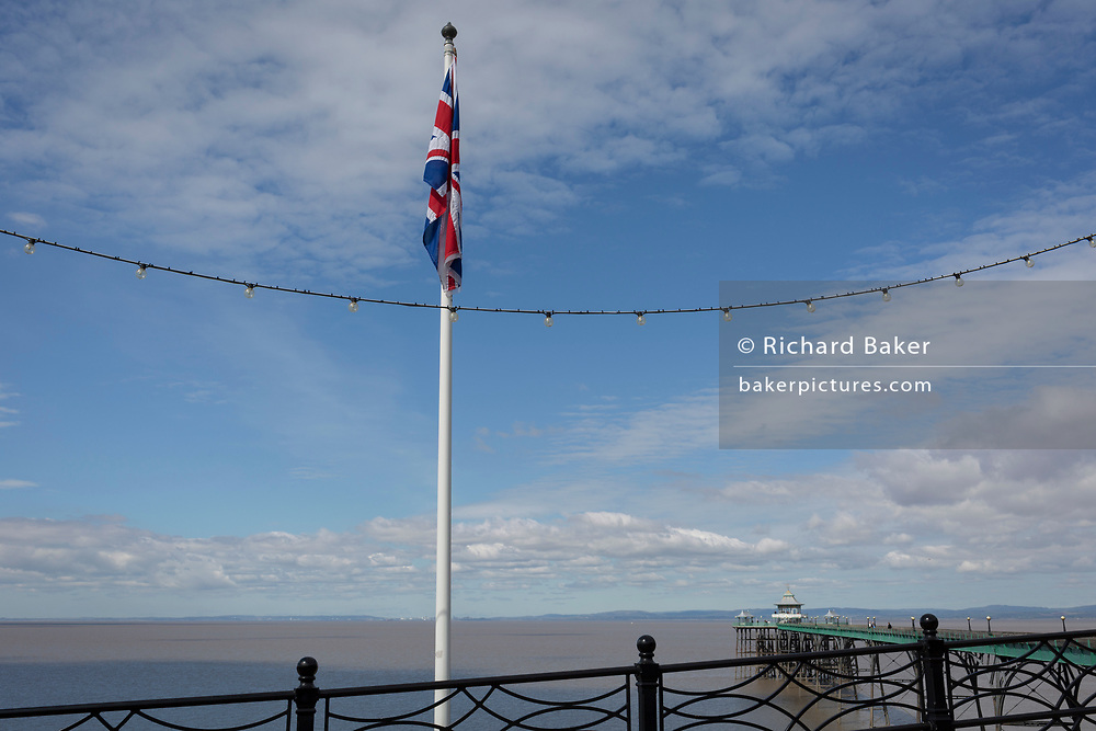 A sad looking Union jack flag hanging from a flagpole at the seaside, on 22nd April 2017, in Clevedon, North Somerset, England.