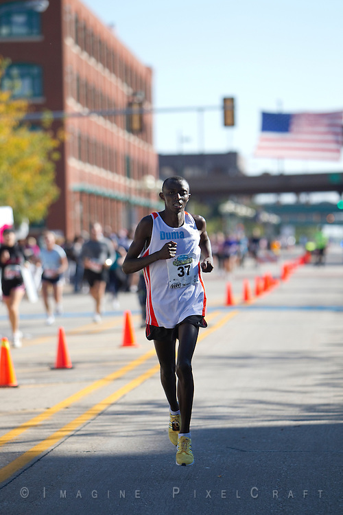 John Maina Njoroge  captured in a photo at the finish line of the Quad Cities Marathon 2010.
