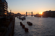 Sunrise over the River Thames looking towards Tower Bridge and HMS Belfast in London, England, United Kingdom.