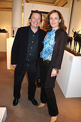 SEBASTIAN CONRAN and GERTRUDE THOME at the annual Sotheby's Summer Party held at their auction rooms 34-35 New Bond Street, London W1 on 19th June 2008.<br />