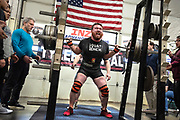David McLavey squats 650 on Saturday in the 19th Annual Ketchikan Powerlifting Meet at Body Mechanics. McLavey was spotted by his father Pat McLavey, who also competed in the event. Staff photo by Dustin Safranek