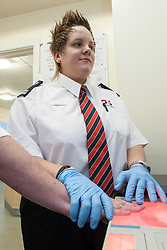 Finger printing by Group 4 Securicor staff in police station, UK