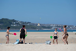 © Licensed to London News Pictures.  13/06/2021. Falmouth, UK. Members of the public enjoy sunny weather on Hayle Beach, Cornwall. Photo credit: Marcin Nowak/LNP