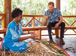 The Duke of Sussex watches a demonstration of traditional mat weaving as he attends a dedication of the Colo-i-Suva forest to the Queen's Commonwealth Canopy in Suva, Fiji, on day two of the royal couple's visit to Fiji.